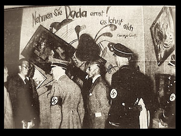 Hitler attending the 'Entartete Kunst' exhibition in 1937