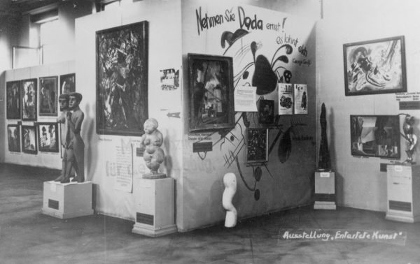 """A Nazi exhibition of """"Degenerate Art"""" at the Munich Hofgarten, 1937. Paul Klee's """"Swamp Legend"""" is hanging at the bottom center of the Dada wall."""