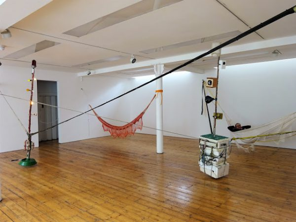 Installation view with hammock occupation