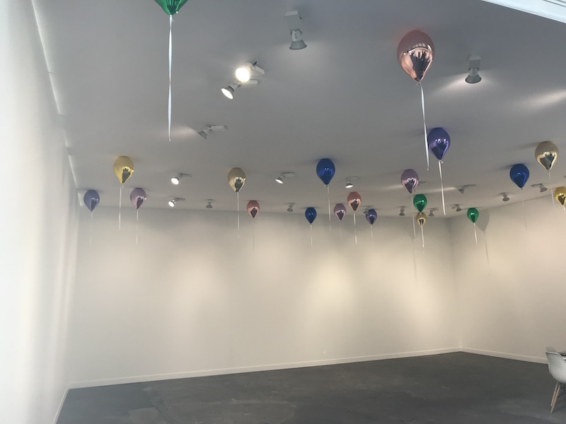 Jeppe Hein's balloons glue on the ceiling at 303 Gallerie