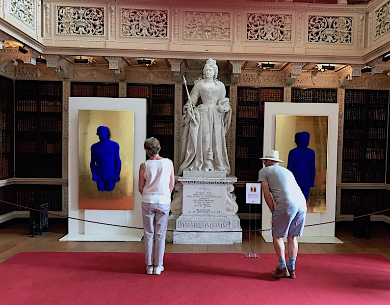 Yves Klein's relief portraits of Arman and Claude Pascal in the Long Library.