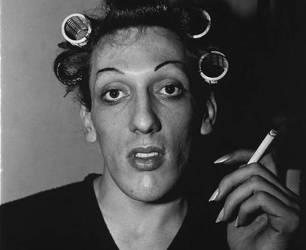 Young man in curlers at home on West 20th Street (1966) by Diane Arbus