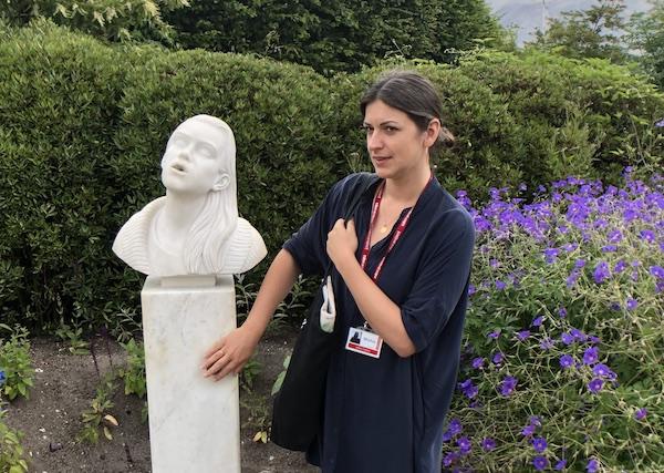 Curator Misha Curson with Sculpture by Ryan Gander