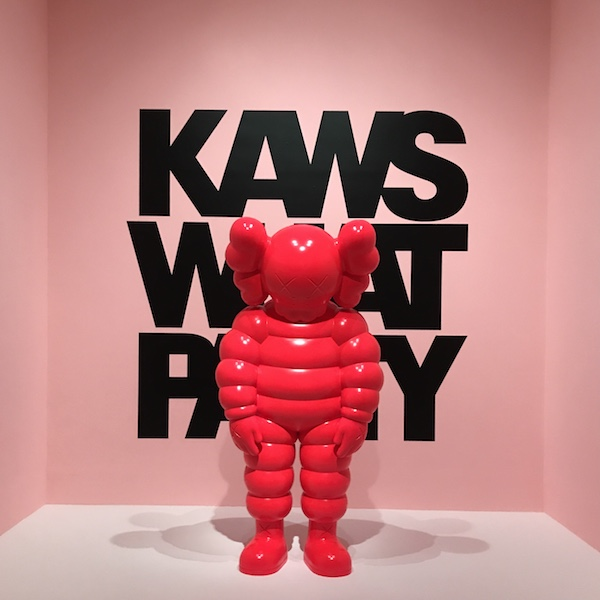 """The sculpture """"What Party"""" greets visitors to """"Kaws: What Party"""" on the fifth floor of the Brooklyn Museum. Courtesy of the artist and Brooklyn Museum, New York."""
